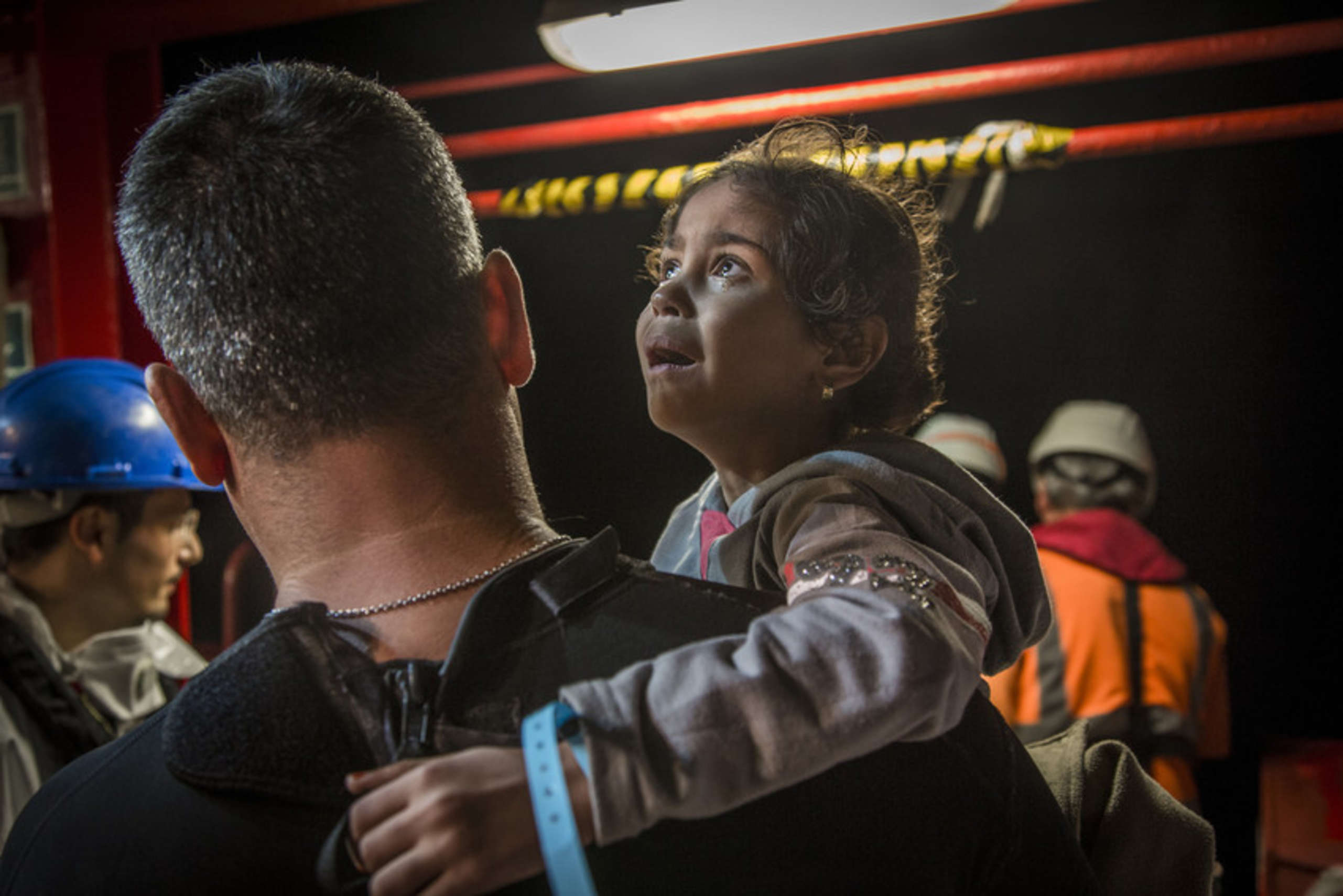 Amena, five, is brought aboard the Vos Hestia after being rescued.