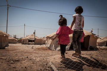Two Syrian refugees in a camp in Jordan