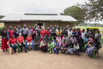 Staff from GSK and Save the Children visit a local community and community health workers during a field visit in Kenya.