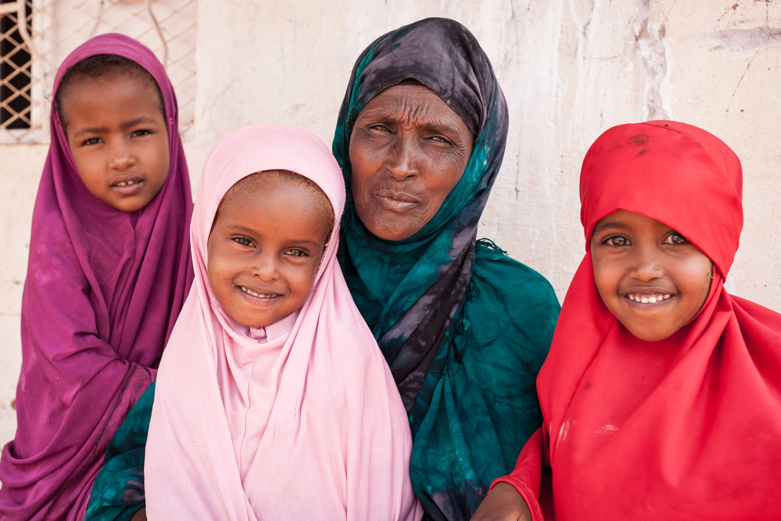 Halimo poses with her granddaughters, recovered from malnutrition in Somalia