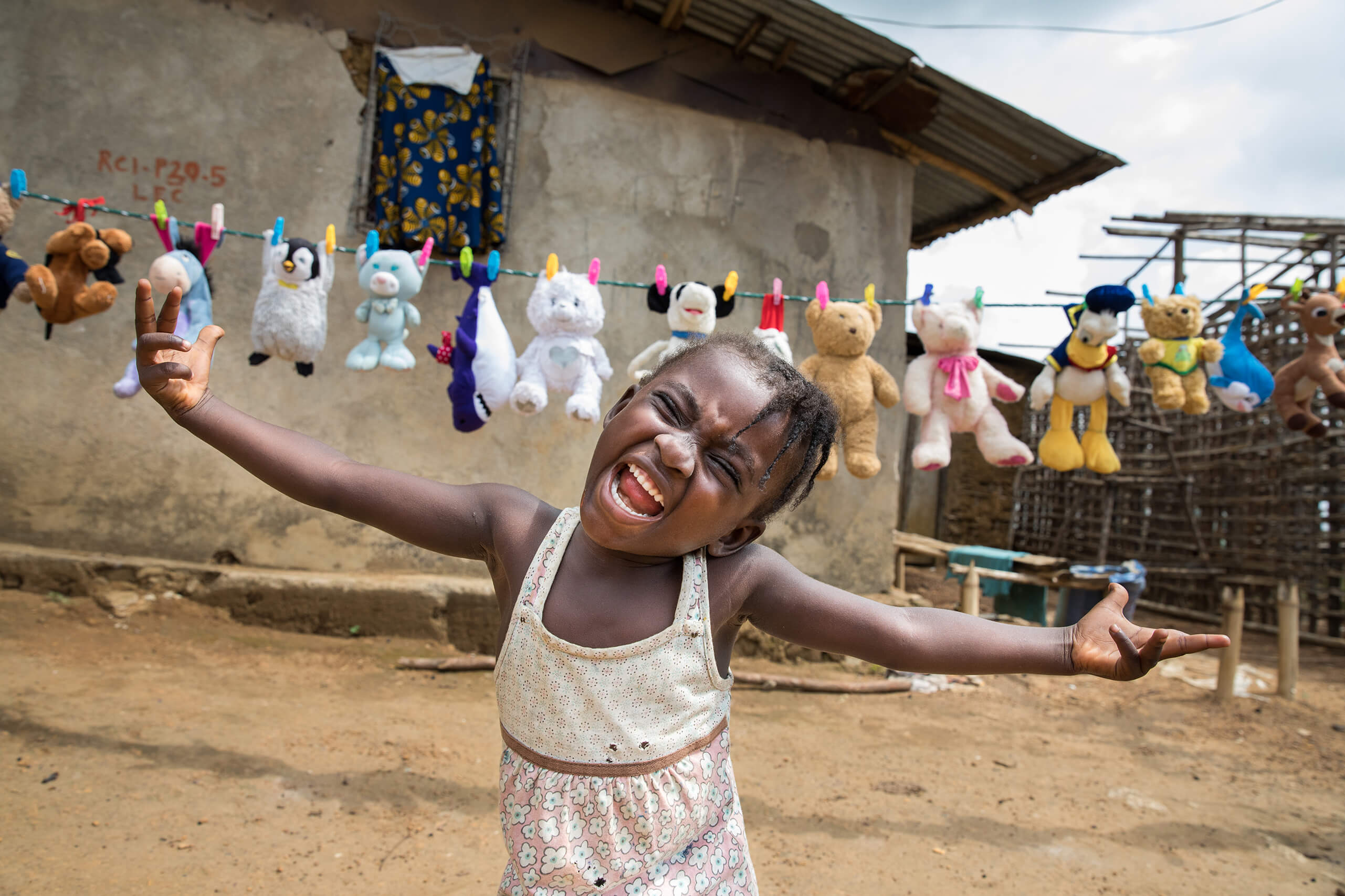 Alice, 4, plays near her home outside White Plains, Liberia. Alice was named after Alice the midwife who delivered her.