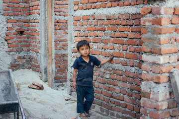 Anoj, six, lives in Nuwakot district in Nepal. His dad was given masonry training and now specialises in safer construction. He is the lead mason rebuilding a new home supported by Save the Children. The family dreams of restarting their new life in the earthquake resistant house.