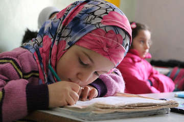 Children learn in a Save the Children supported school in Eastern Aleppo.