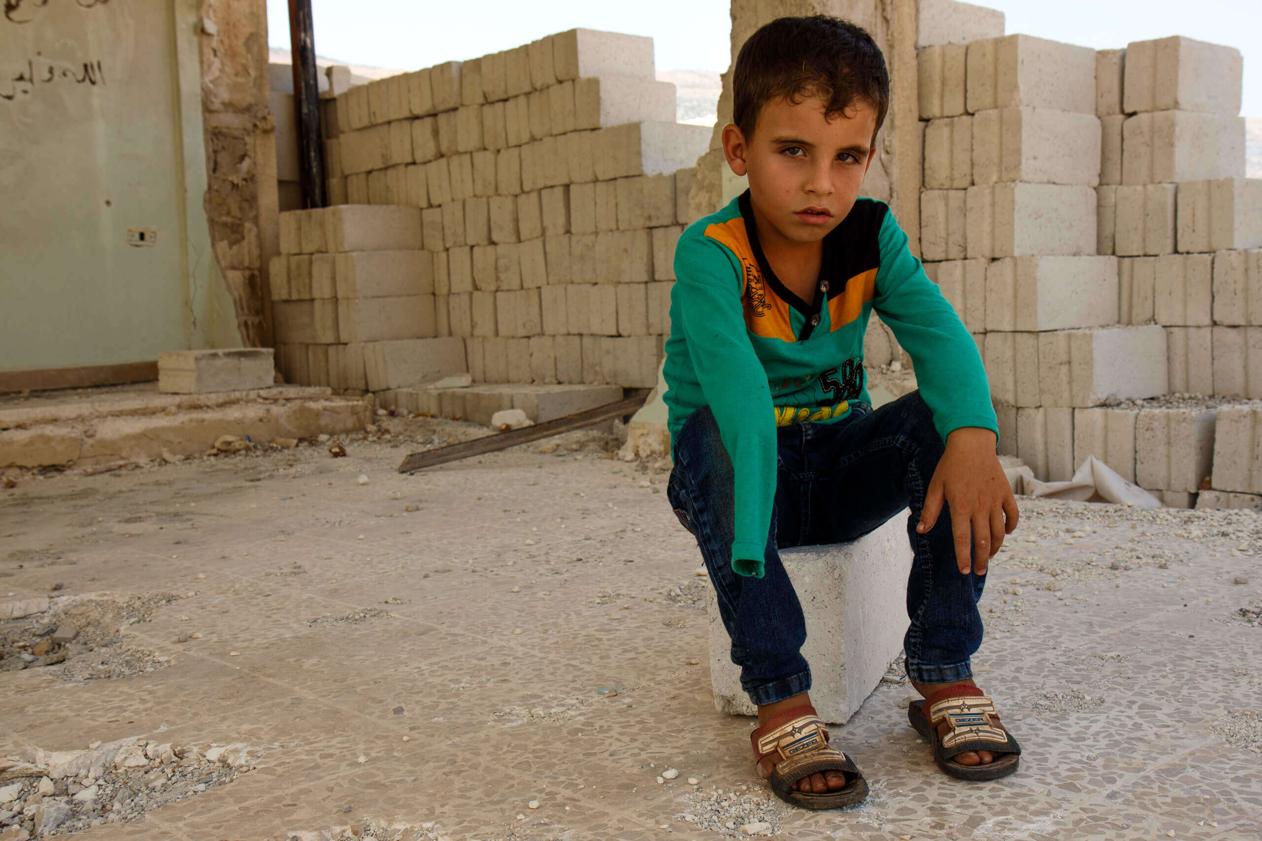 Khalid, 7, suffered severe injuries when his school was attacked in Syria.