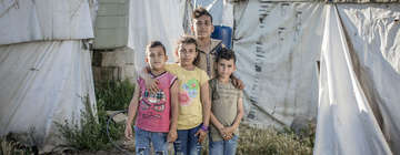 *Siraj, 13 with his siblings in the informal refugee camp, where they live in the Bekaa Valley, Lebanon.