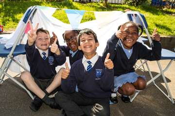 Children from Stewart Fleming primary school take part in Save the Children's Den Day.