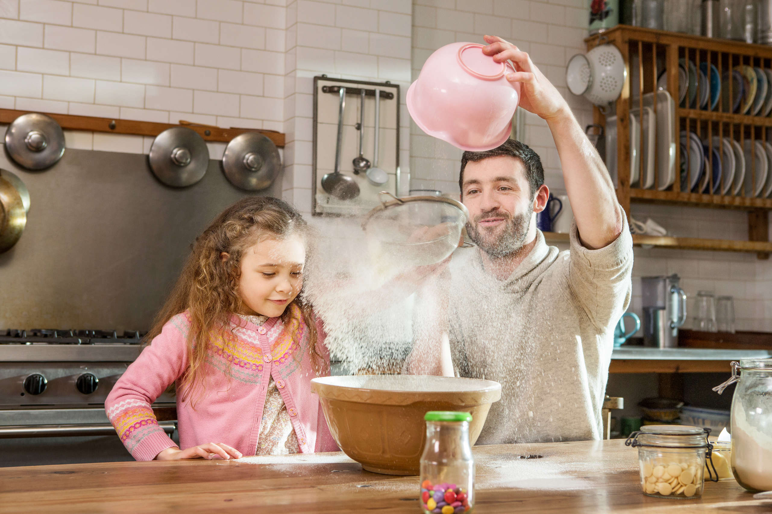 A father and daughter take part in Save the Children's Emergency Bake event.